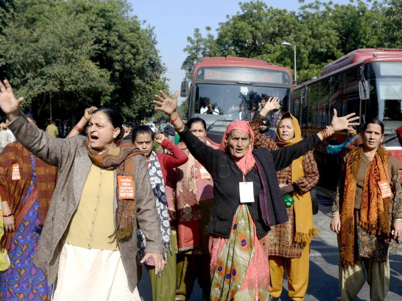 National Federation of Indian Women activists shout slogans during a protest following the gang-rape of a student in New Delhi. The young woman was gang-raped on a moving bus and thrown out of the vehicle. The attack has sparked fresh concern for women's safety in the national Capital. (AFP Photo)