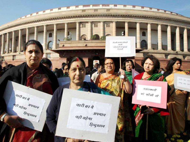 Leader of Opposition Sushma Swaraj, Smriti Irani, Maya Singh and other BJP MPs during a protest at Parliament House against the recent gang rape case. The gang-rape and near fatal beating of a 23-year-old student on a bus not just triggered outrage anger across the country but also rocked the Parliament. (PTI Photo)