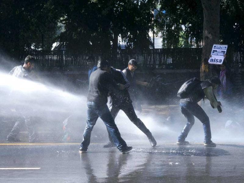 Police use water cannons to disperse the students who were demonstrating against the recent gang rape case, at Chief Minister Sheila Dikshit's residence. (PTI Photo)