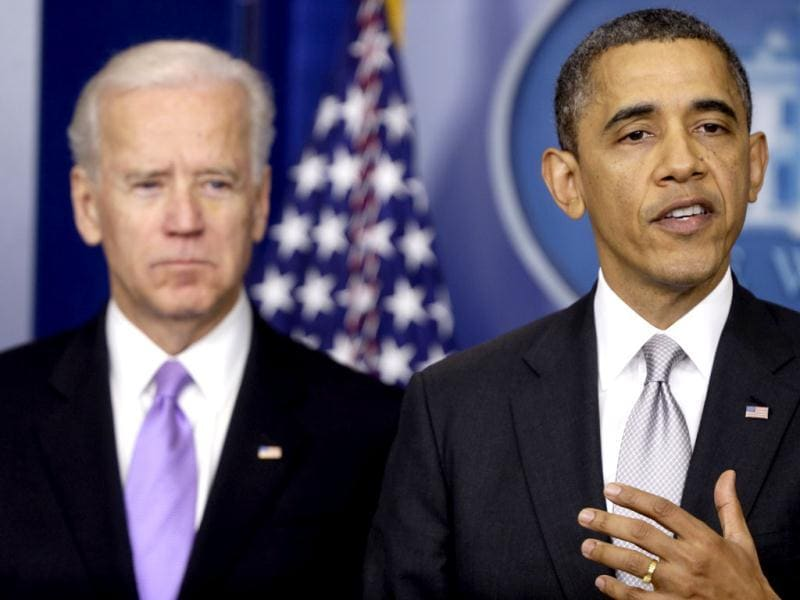 President Barack Obama stands with vice president Joe Biden as he makes a statement in the Brady Press Briefing Room at the White House in Washington, about policies he will pursue following the massacre at Sandy Hook Elementary School in Newtown. AP Photo