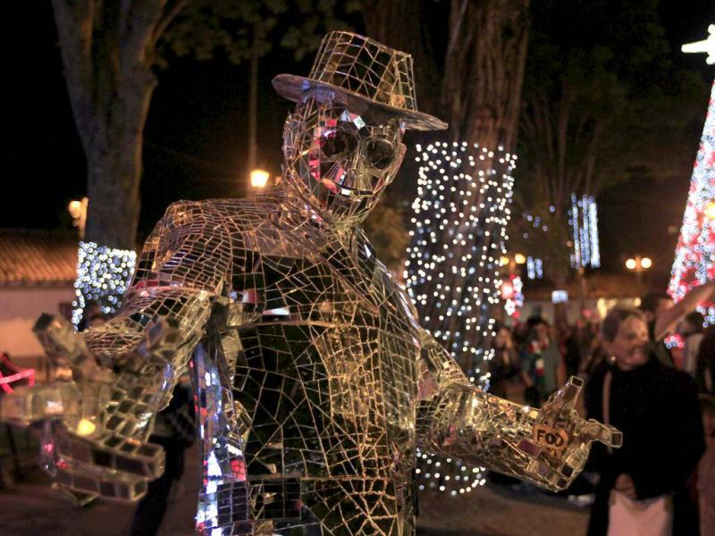 A man in a costume made out of mirrors poses in Usaquen Park during the annual Festival de Navidad (Festival of Christmas) celebrations in Bogota. Reuters Photo
