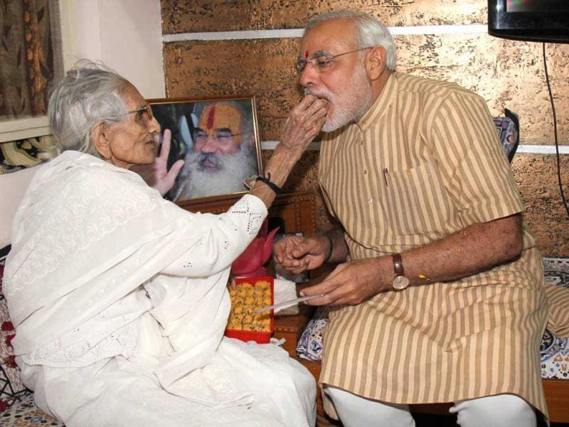 Gujarat chief minister Narendra Modi seeks blessings from his mother after his victory in Gujarat Assembly polls. (UNI Photo)