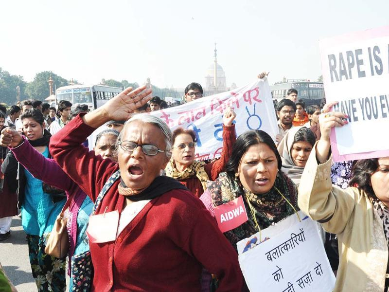 Members of the All India Democratic Women's Association raising slogans during their march to President House to submit a memorandum for strict action against the gangrape culprits in New Delhi. UNI