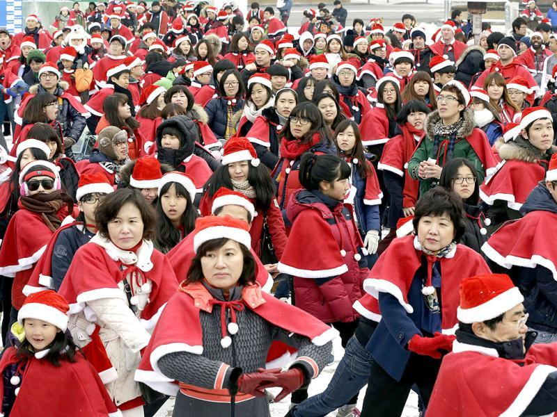 South Koreans wearing Santa Claus costumes exercise before taking part in the Santa Marathon race in Seoul, South Korea. AP Photo