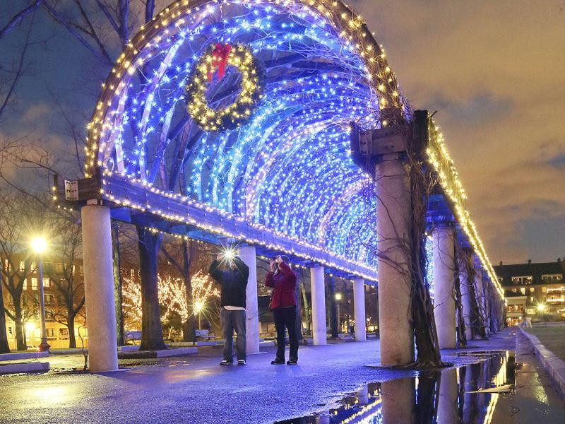 Holiday lights adorn a walkway in Christopher Columbus park on the waterfront in Boston. AP Photo