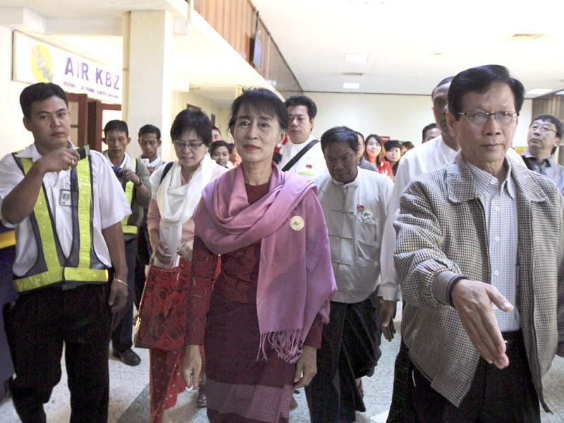 Myanmar opposition leader Aung San Suu Kyi arrives at Yangon Airport in Yangon, Myanmar before she departs for Kawthaung, southern part of Myanmar and border region with Thailand. AP Photo