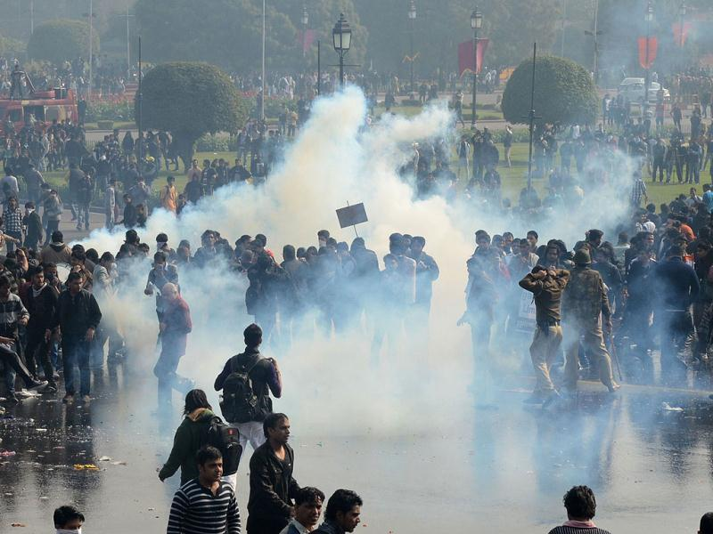 Demonstrators react as police fire tear gas during a protest calling for better safety for women following the rape of a student last week, in front of the Government Secretariat and Presidential Palace in New Delhi. AFP photo