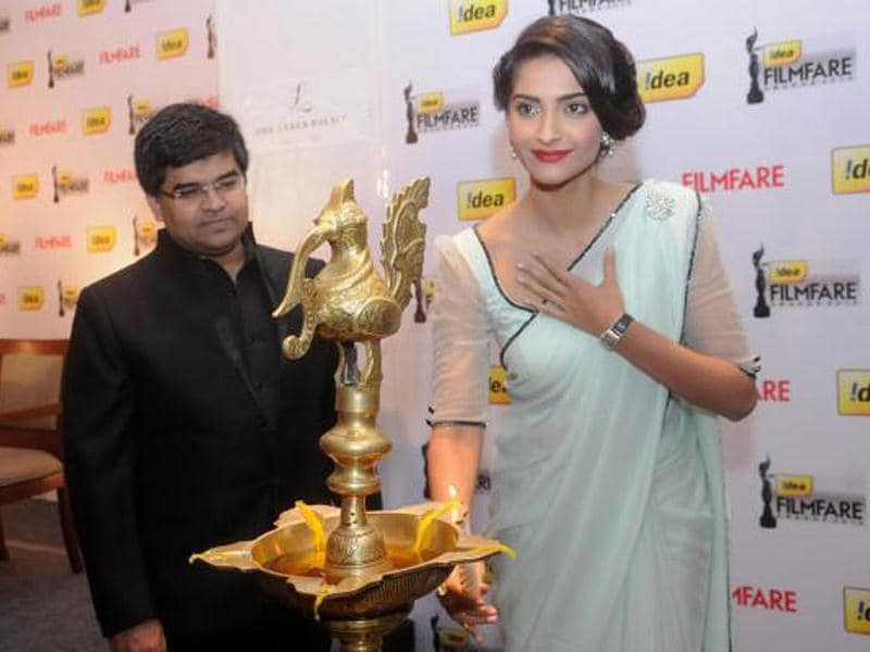 Sonam Kapoor lights the lamp at the 58th Idea Filmfare Awards Press Conference in Bangalore.