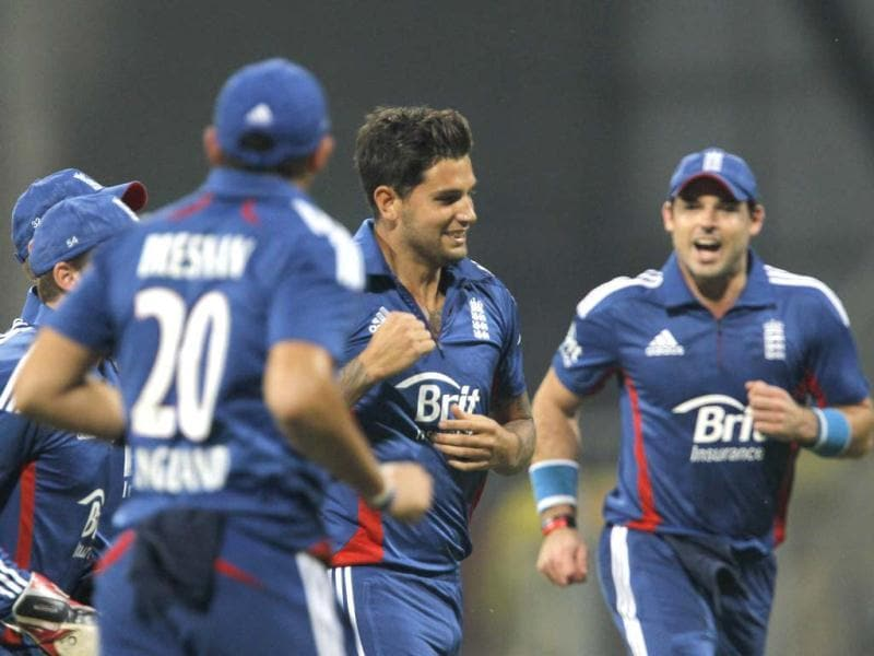 England's Jade Dernbach celebrates with his team mates after he dismissed Ajinkya Rahane during the T20 cricket match at Wankhede Stadium in Mumbai. HT/ Satish Bate