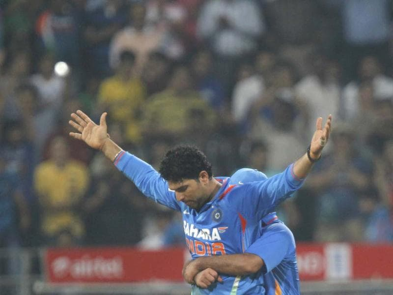 Yuvraj Singh celebrates after he dismissed England's Alex Hales during the T20 cricket match at Wankhede Stadium, in Mumbai. HT/Satish Bate