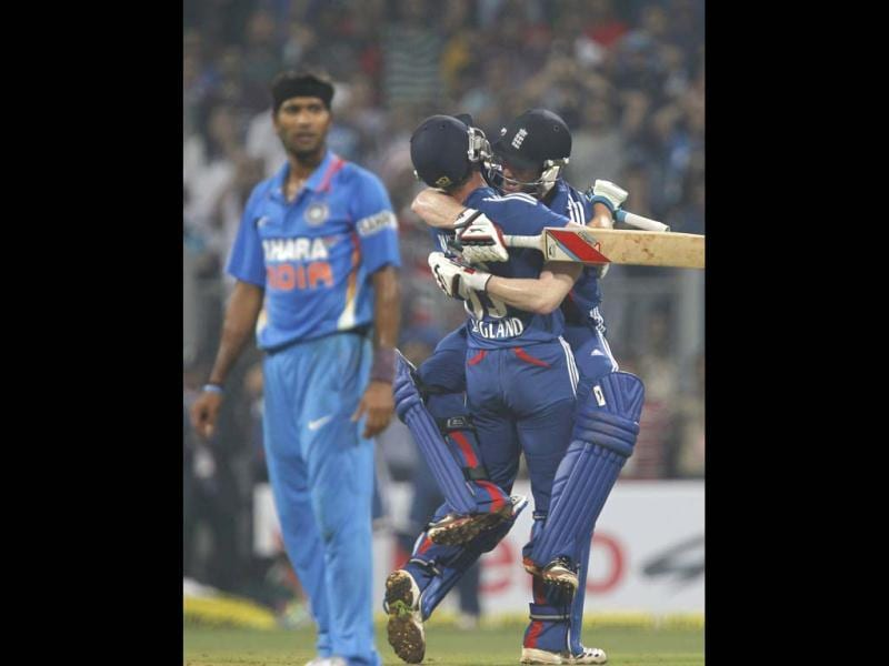 England's batsman Eoin Morgan and Jos Buttler celebrate after winning their second T20 match againt India at Wankhede Stadium in Mumbai. HT/Satish Bate
