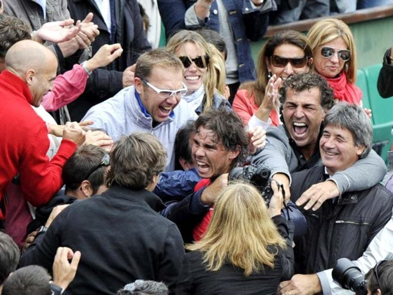 Rafael Nadal celebrates with his sister his staff members and his family after winning against Serbia's Novak Djokovic their Men's Singles final tennis match of the French Open tennis tournament at the Roland Garros stadium, on June 11, 2012 in Paris. AFP Photo