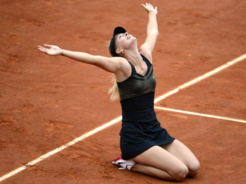 Russia's Maria Sharapova reacts after winning over Italy's Sara Errani during their Women's Singles final tennis match of the French Open tennis tournament at the Roland Garros stadium, on June 9, 2012 in Paris. AFP Photo