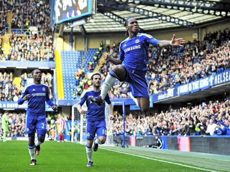 Chelsea's Ivorian striker Didier Drogba celebrates scoring the opening goal of the English Premier League football match between Chelsea and Stoke City at Stamford Bridge in London, on March 10, 2012. AFP Photo