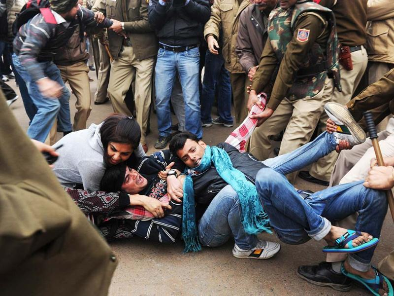Police using force to detain a protester calling for better safety for women in Delhi, in front of the India Gate. AFP Photo