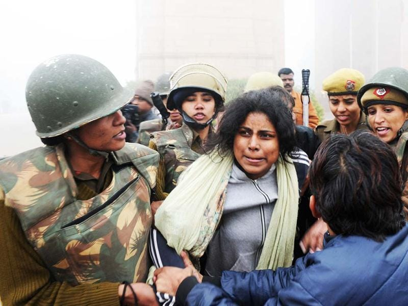 Police detain a demonstrator during a protest calling for better safety for women following the gangrape of a student, in front of the India Gate, New Delhi. AFP Photo