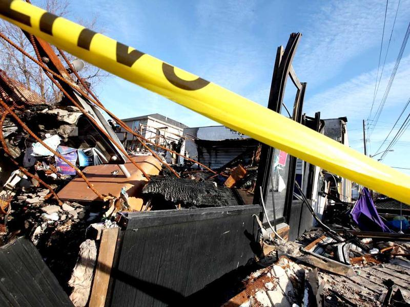 A property destroyed by fire following Superstorm Sandy remains blocked by police tape in the Midland Beach neighborhood which was heavily damaged by Sandy in the Staten Island borough of New York City. Getty Images/AFP Photo