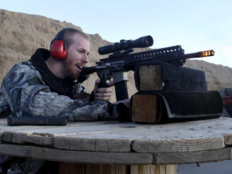 Michael Reed, of Cedar Park, Texas, shoots an AR-15 rifle, the muzzle flash visible as the bullet exits the barrel, at Dragonman's firing range and gun dealer, outside Colorado Springs. AP Photo