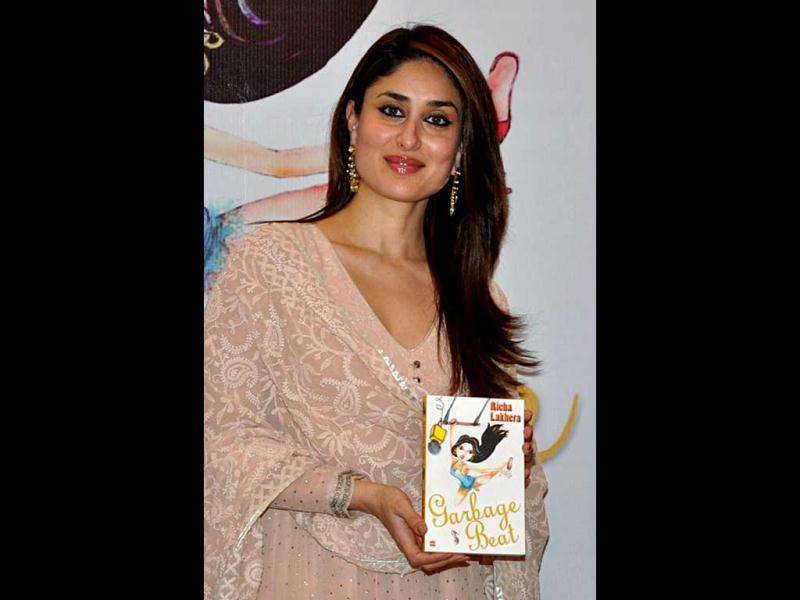 Kareena poses with the book at the event. (AFP Photo)