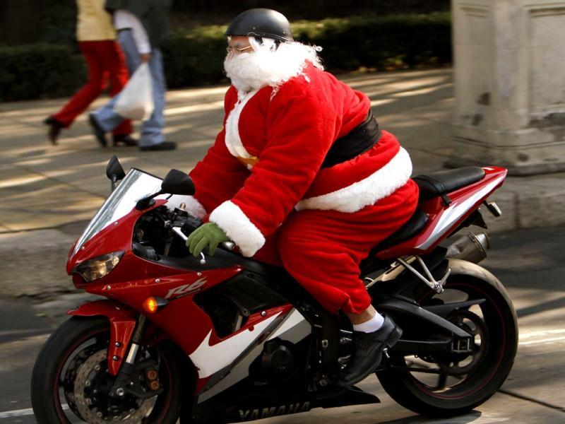 A man disguised as Santa Claus rides a motorcycle in Mexico City. (AP Photo)