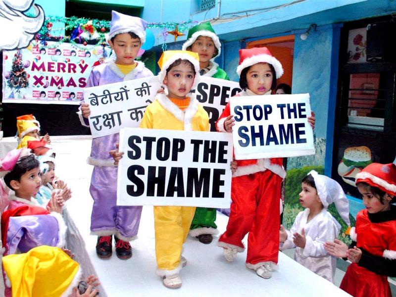 Tiny tots take part in 'Pretty Santa Fashion' show with the message 'Respect Girls' on the eve of Christmas in Bhopal. (PTI Photo)