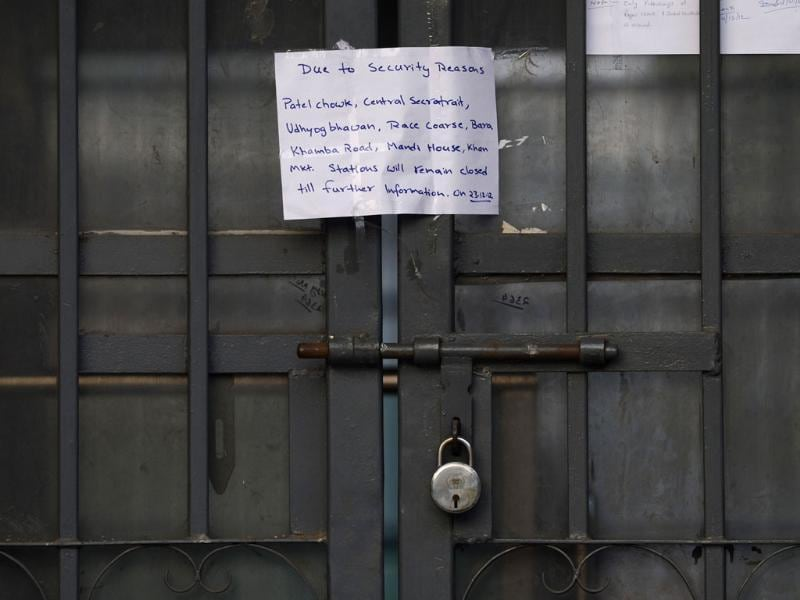 A handwritten notice is seen at the entrance of a Delhi Metro station following following weekend clashes between demonstrators and police in New Delhi. AFP/Sajjad Hussain