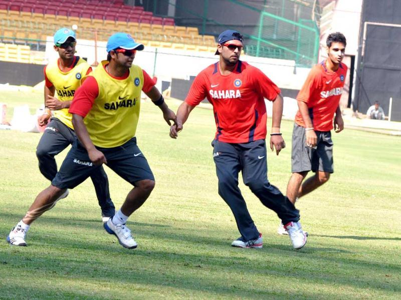 Indian cricketers Yuvraj Singh and Suresh Raina during the practice session at Chinnaswamy stadium in Bangalore on Monday.
