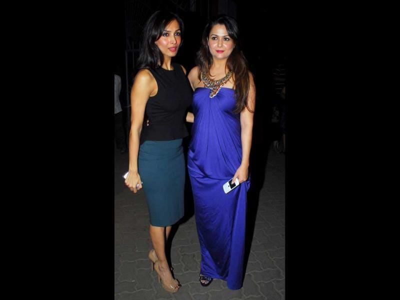 Malaika wore a sobre black top and blue pencil skirt while newly-turned-mommy Amrita Arora was seen in a peacock blue satin gown with an elaborate neckpiece on Christmas eve.