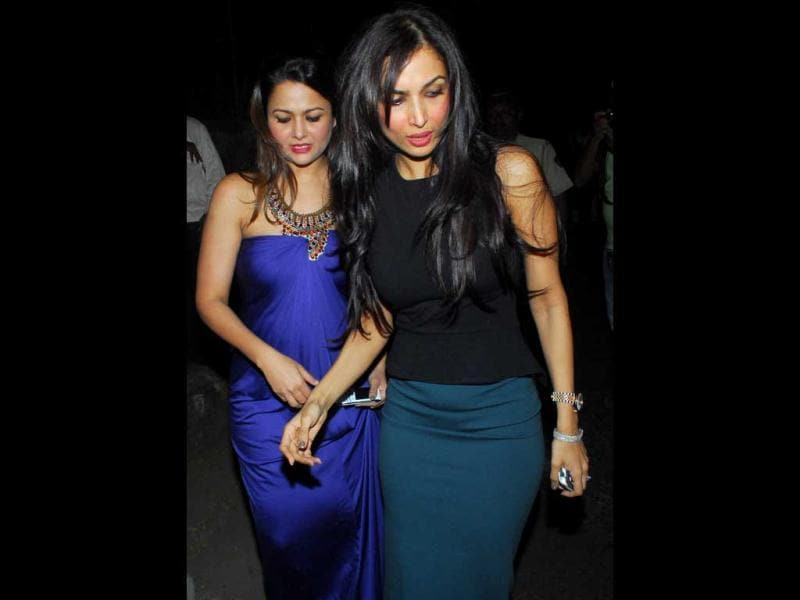 Sisters Amrita Arora and Malaika Arora Khan (right) were also seen attending mass on Christmas eve at a church in Bandra, Mumbai.