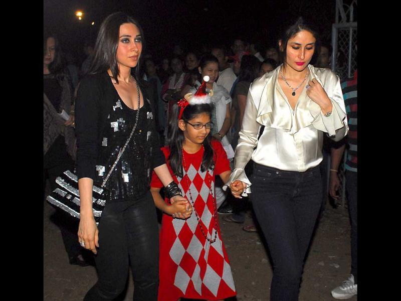 Karisma Kapoor, seen with daughter Samaira (center) and sister Kareena on Christmas eve.
