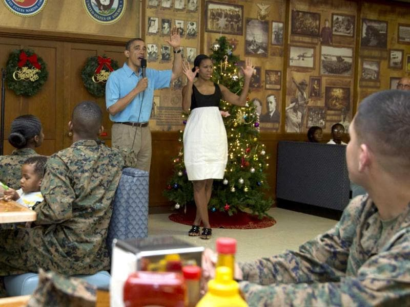 President Barack Obama and first lady Michelle Obama visit with members of the military and their families in Anderson Hall at Marine Corp Base Hawaii. AP photo