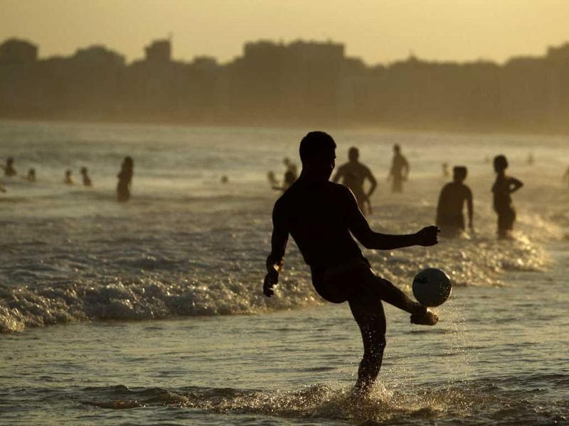 A man kicks a ball at the Copacabana beach in Rio de Janeiro. Reuters photo