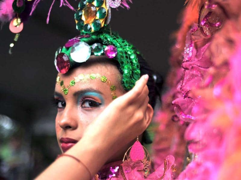 A young dancer prepares for the Salsodromo parade, which marks the start of the 55th Fair of Cali in Cali, Colombia. AFP Photo