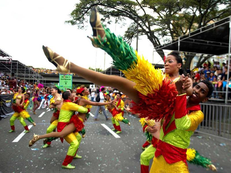 Young dancers perform in the Salsodromo parade, which marks the start of the 55th Fair of Cali in Cali, Colombia. AFP Photo