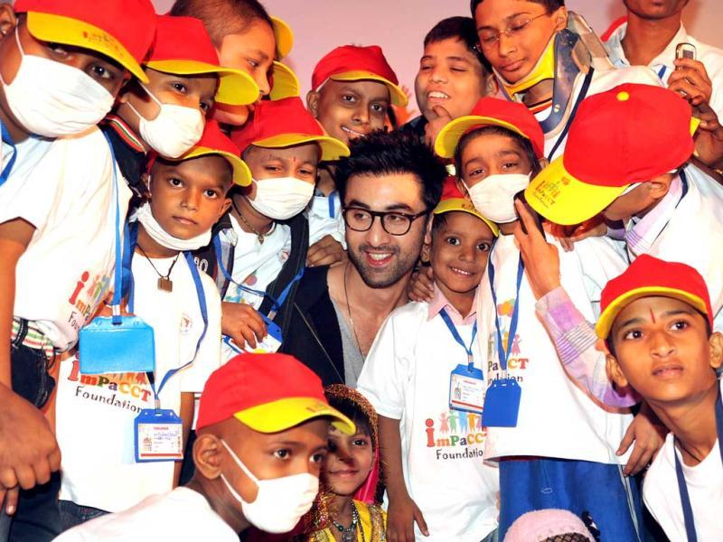 Ranbir Kapoor (C) poses during a Christmas performance for cancer affected children at The Tata Memorial Hospital in Mumbai on December 25, 2012. AFP PHOTO