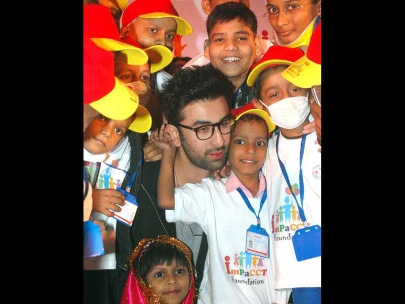 Actor Ranbir Kapoor dances during an event organised to celebrate Christmas with cancer affected children in Mumbai on monday. UNI PHOTO