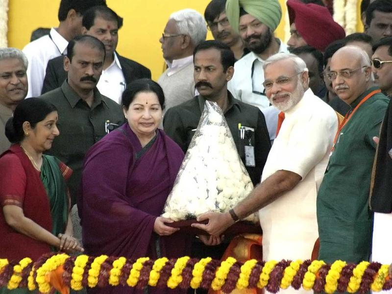 Tamil Nadu Chief Minister Jaylalitha greeting her Gujarat counterpart Narendra Modi during swearing in ceremony at Sardar Patel stadium in Ahmedabad. The presence of Jayalalithaa, added grist to speculation about a possible realignment of her AIADMK with BJP-led NDA. (UNI Photo)