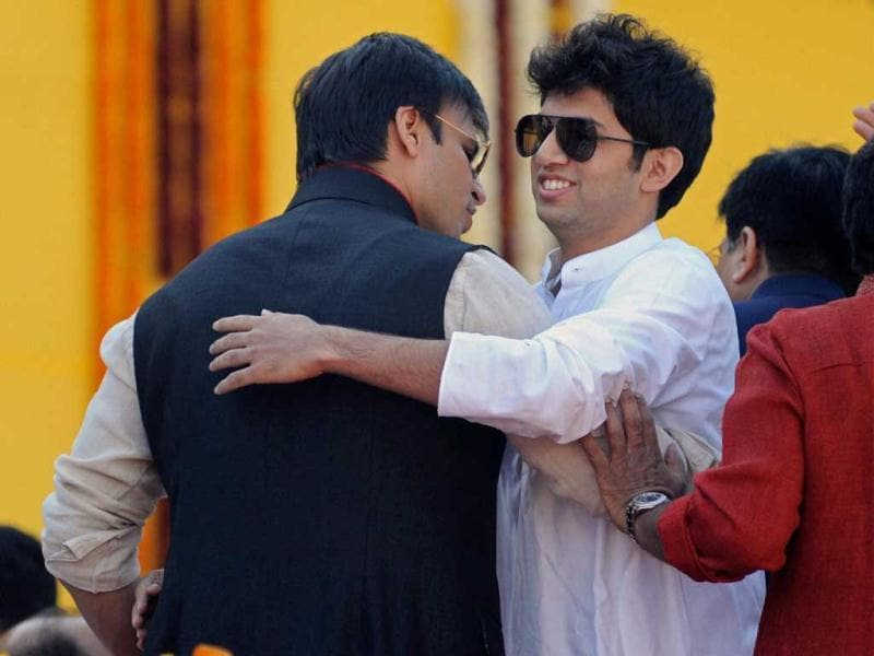 Actor Vivek Oberoi greets Shiv Sena's Aaditya Thackeray during Gujarat Chief Minister Narendra Modi's oath taking ceremony at Sardar Patel Stadium in Ahmedabad. Modi, who led the BJP to an emphatic victory in the Assembly elections, was on Wednesday sworn in as Gujarat CM for the fourth time. (PTI Photo)