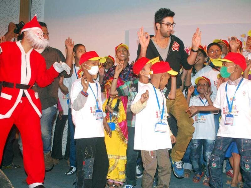 Bollywood actor Ranbir Kapoor dances during an event organised to celebrate Christmas with cancer affected children. UNI PHOTO