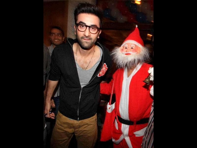 Ranbir Kapoor poses with a child dressed as Santa Claus as he celebrates Christmas with cancer affected children in Mumbai. PTI Photo