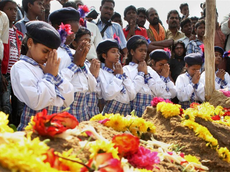 School children offer prayers for the victims of the 2004 tsunami at Marina Beach in Chennai. PTI/R Senthil Kumar