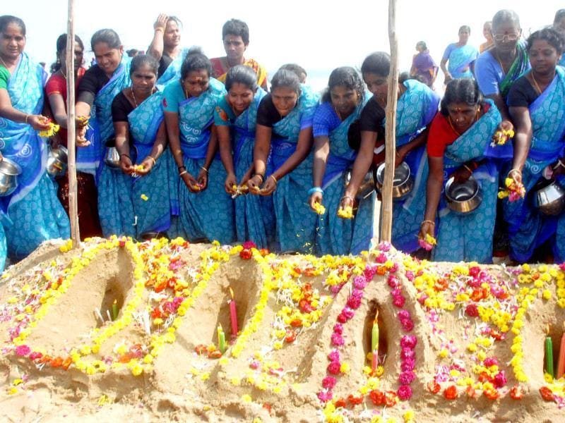 Fisherwomen paying tribute to tsunami victims of the 2004 tsunami at Marina Beach in Chennai. UNI