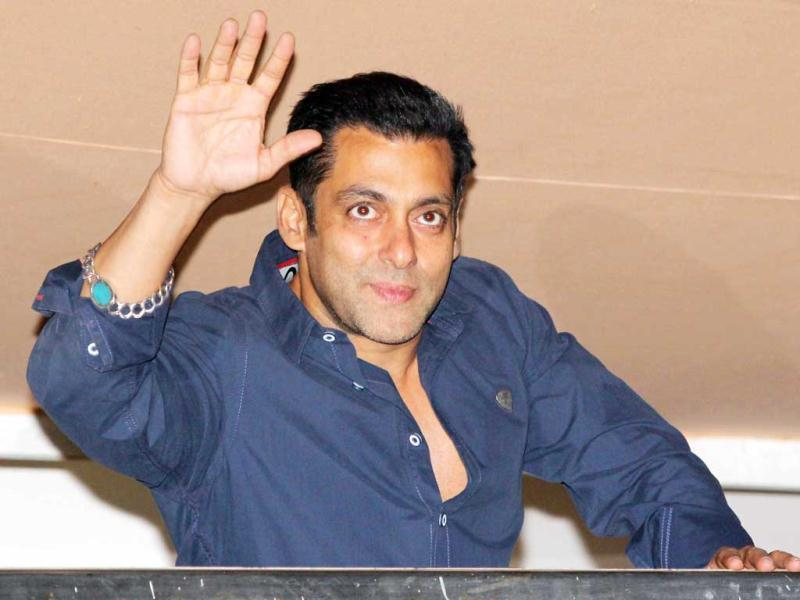 Salman Khan waves at fans on his birthday on December 28, 2012. A Firoza bracelet can be seen on his wrist.