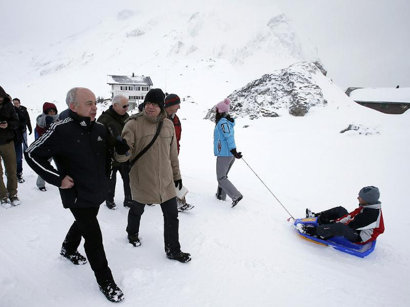Swiss defence minister and Swiss president for 2013 Ueli Maurer walks in the snow with journalists during his annual media event on the Engstligenalp. Reuters/Pascal Lauener