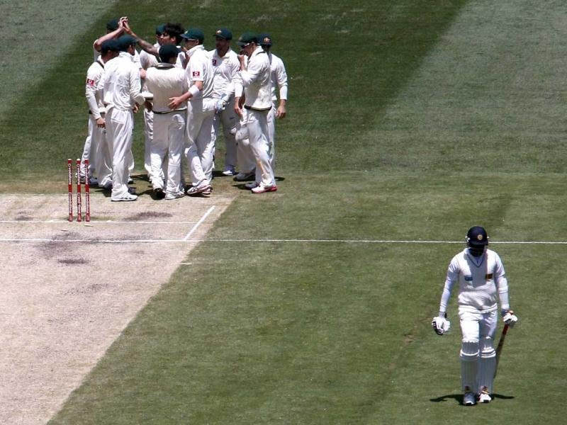 Sri Lanka's Angelo Mathews (R) walks off after being bowled by Australia's Mitchell Johnson for 35 runs during the third day of the second cricket Test at the Melbourne Cricket Ground. (Reuters)