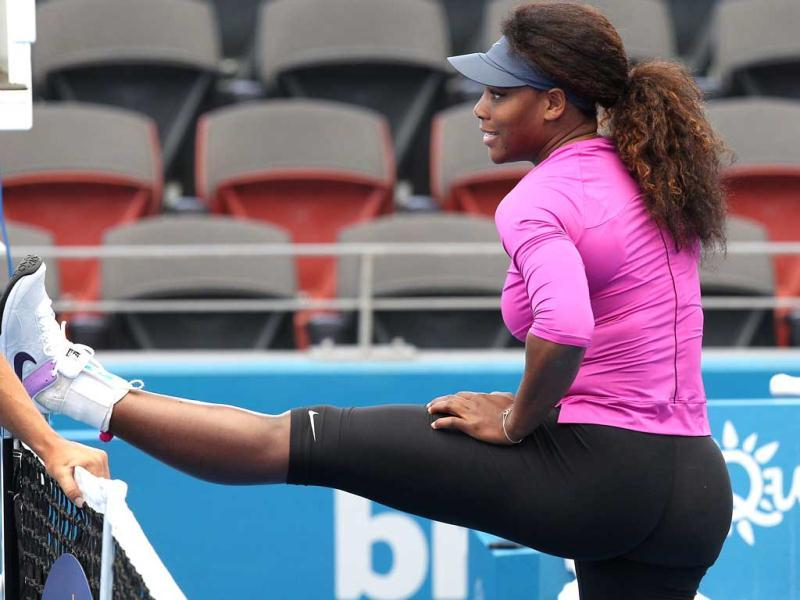 Serena Williams of the US stretches during her first training session in Brisbane for the upcoming Brisbane International tennis tournament. (AFP Photo)