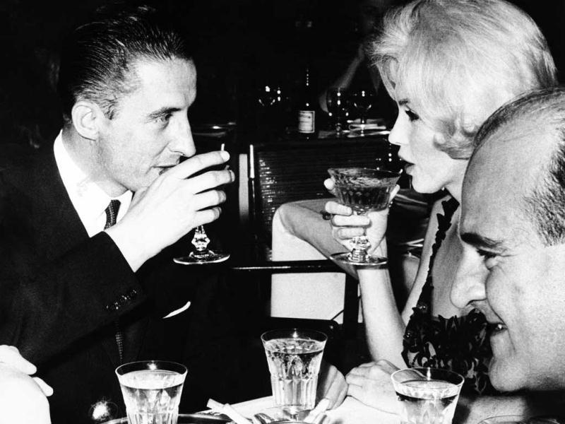 In this 1962 file photo, Marilyn Monroe and Jean Pierre Piquet, left, manager of Continental Hilton Hotel, are seen lifting their champagne glasses at a reception offered to the visiting star, in Mexico City. In late 2012, the FBI has released a new version of files it kept on Monroe that reveal the names of some of her acquaintances who had drawn concern from government officials and members of her entourage over their suspected ties to communism. (AP Photo)