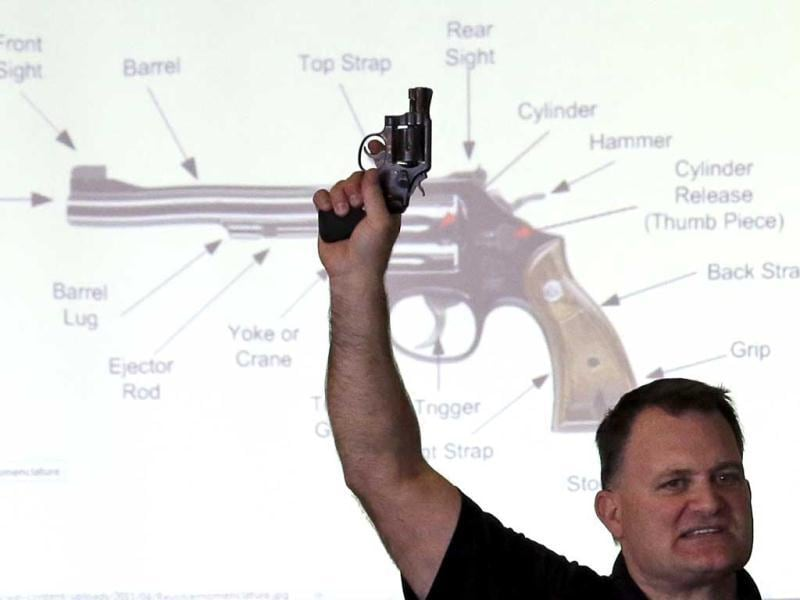 Clark Aposhian, President of Utah Shooting Sport Council, holds a pistol during concealed weapons training for 200 Utah teachers in West Valley City, Utah.(AP Photo)