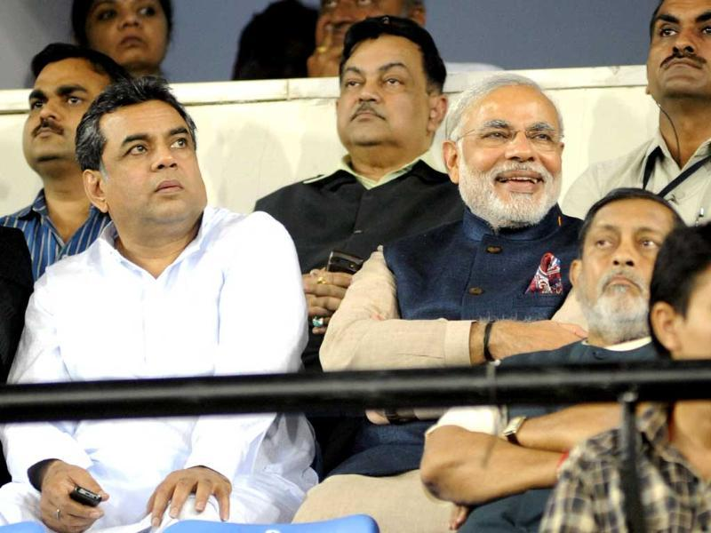 Gujarat CM Narendra Modi, actor Paresh Raval and Amit Shah watch the second T20 match between India and Pakistan in Ahmedabad. PTI