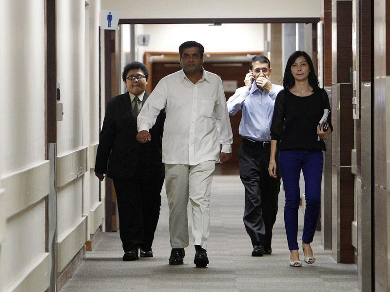 Indian high commissioner to Singapore TCA Raghavan walks down the corridor to speak to journalists about the passing of the gang rapevictim, outside the ICU ward of Mount Elizabeth Hospital in Singapore. Reuters photo